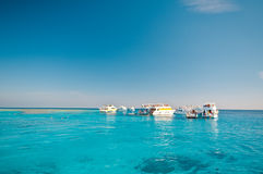 Yachts in blue lagoon Stock Image
