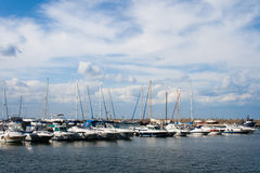 Yachts and boat. S anchored in sea port stock images