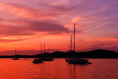 Yachts and boats at Adriatic sea. Bay in sunset light Stock Images