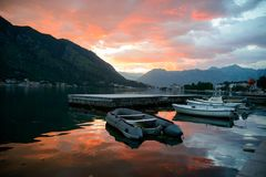Yachts and boats at Adriatic sea bay at sunset in golden and pink tones. Porto Montenegro, Tivat stock photos