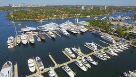Yachts and boats docked in harbor stock image