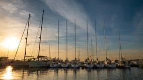 Yachts and boats docked at the harbor Molo of Sopot. stock photos