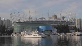 Yachts and boats in front of BC place Vancouver. VANCOUVER,CANADA - CIRCA December 2014 :yachts and boats in front of BC place Vancouver stock video footage