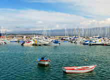 Yachts and boats in harbor Stock Photos