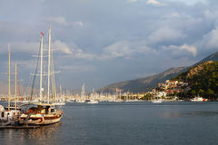 Yachts and boats in the harbor Royalty Free Stock Image