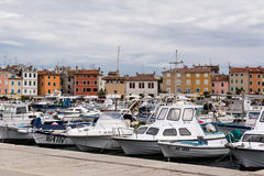 Yachts and boats in harbor stock images
