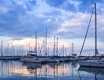 Yachts and boats in harbour at sunset Royalty Free Stock Photos
