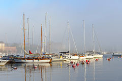Yachts and boats in haze early morning Royalty Free Stock Images