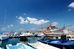 Yachts and boats in marina Stock Images