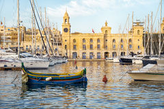 The yachts and boats moored in the harbor in Dockyard creek. Bir. The yachts and boats moored in the harbor of Dockyard creek in front Malta Maritime museum Stock Image