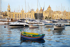 The yachts and boats moored in the harbor in Dockyard creek. Bir. VALLETTA, MALTA - JULY 31, 2015:  The yachts and traditional maltese boats moored in the harbor Stock Images