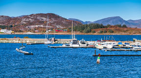 Yachts and boats moored in marina of Brekstad Stock Photos