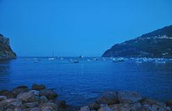 Yachts and boats near Aragonese castle. Standing on the anchors in the evening Stock Image