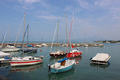 Yachts and boats in Peschiera del Garda harbor, Lake Garda Royalty Free Stock Images
