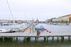 Yachts and boats at the pier in the port of Helsinki Stock Photos