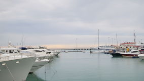 Yachts and boats in port or harbor. View from pier stock video