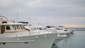Yachts and boats in port or harbor. View from pier stock footage