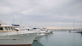Yachts and boats in port or harbor. View from pier stock video footage