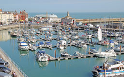 Yachts And Boats at Ramsgate Mariner. This photo shows a view looking down on Ramsgates mariner with its many yachts and boats.  This photo could be used to Stock Image