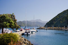 Yachts and boats rest in small marina. Picton marina in Queen Charlotte sound, New Zealand stock photos