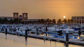 Yachts and boats at the Sharq Marina at sunset timelapse in Kuwait. Kuwait City, Middle East. Yachts and boats at the Sharq Marina with fish market at sunset stock footage