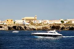 Private yacht sailing along Tabarca Island in Spain. Royalty Free Stock Images