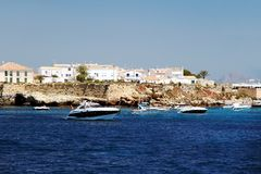 Private yacht sailing along Tabarca Island in Spain. Stock Photos