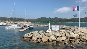 Yachts in the port of Grimaud. Yachts and buildings in the port of Grimaud France stock video footage