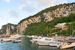 The yachts. CAPRI, ITALY - OCTOBER 3, 2012: The yachts are ready for the tourist trips around the island and along the coastline of the Gulf of Naples, on royalty free stock image