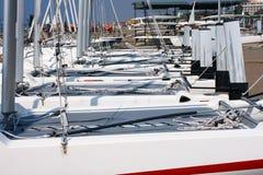 Yachts on coast. Yachts at coast. Fragments of yachts close up Royalty Free Stock Photos