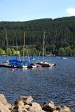 Yachts on coast of lake Stock Images