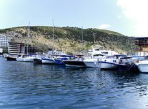 Yachts in Crimea. Snow-white yachts stand at the pier in the Crimea royalty free stock photography