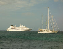 Yachts and a cruise ship at admiralty bay, bequia. Vessels anchored in the shelter of bequia's harbor in the windward islands Royalty Free Stock Photography