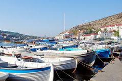 Yachts, cutters, launches and boats, which are moored at the waterfront of of Balaklava. Crimea Stock Photography
