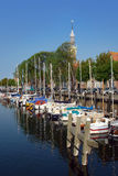Yachts docked in an old Holland port. Yachts docked in an old picturesque Dutch historical port in Veere, Zeeland royalty free stock photos