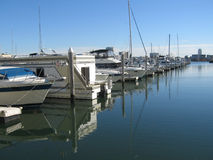Yachts docked at pier Stock Photos
