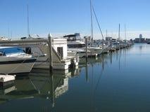 Yachts docked at pier stock photos