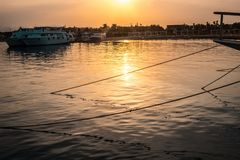 Yachts docked in the seaport at sunset. royalty free stock photo