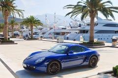 Yachts et voiture de sport de luxe Photographie stock libre de droits