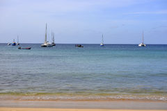 Yachts and Fishing Boat with People Inside, Sand Beach, Cape Verde Royalty Free Stock Images