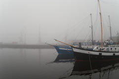 Yachts in the fog Stock Images