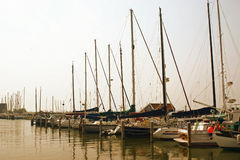 Yachts in a harbor. Yachts with massive masts parked near the seaside in Holland 2007 Stock Image