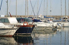 Yachts at harbor. In small city on the Mediterranean sea Royalty Free Stock Photography