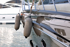Yachts in harbor. Hanging floater of a beautiful yacht stop in harbor, shown as luxury yacht hardware and facilities, maritime activity, maintenance or enjoy Stock Photography