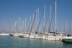 Yachts in the harbor Stock Images