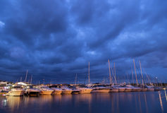 Yachts in a harbor evening stock image
