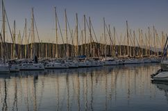 Yachts in the harbor in Fithiye, Turkey. Many yachts in the harbor in Fithiye with reflection of the masts in thr water Royalty Free Stock Photos