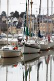 Yachts in harbor of french town Stock Photo