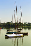 Yachts in harbor of river. Silhouettes of private yachts covered with tarpaulin in harbor of river Stock Photo