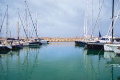 Yachts in the harbor standing on an anchor Royalty Free Stock Photos